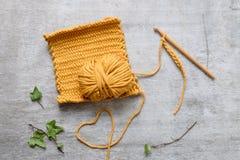 Ball of yellow yarn with crochet hook Stock Photography