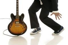 Ballando con la chitarra Fotografie Stock