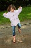 Ballando nel fango Immagine Stock
