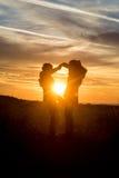 Ballando nel tramonto Fotografia Stock Libera da Diritti