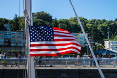 Ballard Lock Yacht Flying American Flag Stock Photo