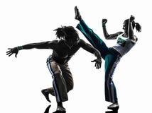 Ballare dei ballerini di capoiera delle coppie   siluetta Immagine Stock