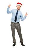 Ballare felice dell'uomo d'affari eccitato circa l'indennità di Natale in pieno len Fotografia Stock