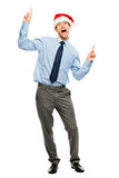 Ballare felice dell'uomo d'affari eccitato circa l'indennità di Natale in pieno len Immagine Stock Libera da Diritti