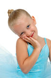 Ballarina Cute. Little girl ballerina with her head tilted and resting on hand. Blue tutu royalty free stock images