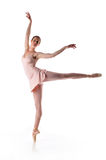 Ballarina performing. Ballerina performing a dance against a white background Stock Images
