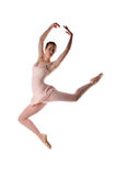 Ballarina performing. Ballerina performing a dance jump against a white background Royalty Free Stock Image