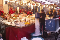 Ballaro, Palermo- selling fish. PALERMO - DECEMBER 22: men selling fish on the local market in Palermo, called Ballaro. This market is also tourist attraction in Royalty Free Stock Photo