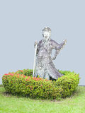 A ballast. In chinese costume standing in small garden Royalty Free Stock Images