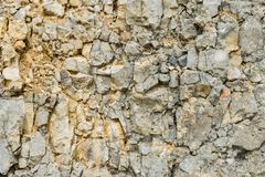 Ballast en pierre texturisé de blocaille de fond en forme naturelle dans le mur de roche image libre de droits