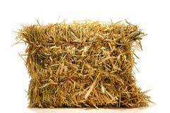 Balle de foin agricole normal de paille au-dessus de blanc Images stock