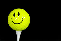 Balle de golf heureuse de visage Photo libre de droits