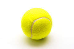 Balle de tennis verte sur le fond blanc Photo libre de droits