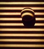 Balle en bois dans les abat-jour d'ombre Photographie stock libre de droits