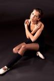 Ballerina συνεδρίασης που ανατρέχει Στοκ Εικόνα