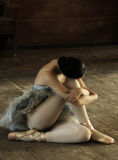 Ballerina. Siting on the studio floor and resting Stock Photos