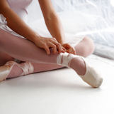 Ballerina. Tying shoes stock image