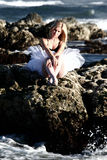 Ballerina. On rocks in ocean Royalty Free Stock Image