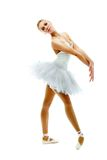 Ballerina. Portrait of charming ballerina performing dance on white Royalty Free Stock Photos