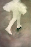 Ballerina. Legs of a little ballerina wearing tutu and ballet slippers; aged and sepia tone stock photos