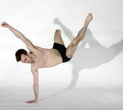 Ballerina. Professional muscular male dancer leaping Royalty Free Stock Photo