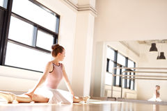 Ballerina Admiring Reflection of Self Doing Splits Royalty Free Stock Image