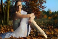 Ballerina against autumn forest. Fall season Royalty Free Stock Images