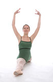 Ballerina with arms up. Graceful ballerina doing a split with her arms up Royalty Free Stock Photography