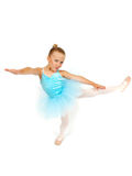 Ballerina Attitude. Little ballerina girl kicks her legs out and points her foot in the air. Smile on her face. She is confident she can do it royalty free stock image