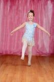 Ballerina balancing on one leg Stock Photography