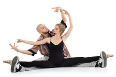 Ballerina and bald breakdancer sit on floor Stock Photo