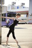 Ballerina. In pointe shoes dancing on the street royalty free stock images
