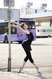 Ballerina. In pointe shoes dancing on the street royalty free stock photo