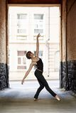 Ballerina. In pointe shoes dancing on the street royalty free stock photography