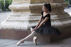 Ballerina. Ballet dancer (ballerina) sitting outdoors Stock Photo