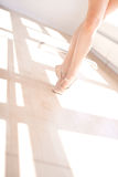 Ballerina in Ballet Slippers on Toes in Studio Royalty Free Stock Photo