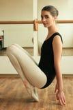 Ballerina. Beautiful ballerina posing in front of mirror in the dance studio Royalty Free Stock Photography