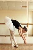 Ballerina. Beautiful ballerina posing in front of mirror in the dance studio Royalty Free Stock Photos