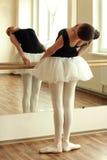 Ballerina. Beautiful ballerina posing in front of mirror in the dance studio Stock Photo
