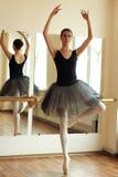 Ballerina. Beautiful ballerina posing in front of mirror in the dance studio Stock Photography