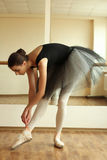 Ballerina. Beautiful ballerina posing in front of mirror in the dance studio Stock Photos