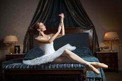 Ballerina in bedroom and holding pearl necklace Stock Image