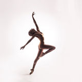 Ballerina in beige outfit posing on toes Stock Image