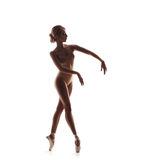 Ballerina in beige outfit posing on toes Royalty Free Stock Images