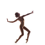 Ballerina in beige outfit posing on toes Royalty Free Stock Photography