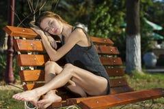 Ballerina on bench Stock Photos