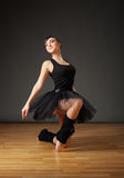 Ballerina in black costume Stock Photography