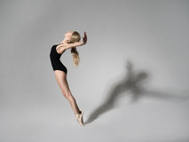 Ballerina in black outfit posing on toes Stock Image