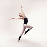 Ballerina in black outfit posing on toes Stock Photography
