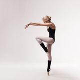 Ballerina in black outfit posing on toes Royalty Free Stock Photography